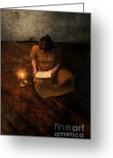 Schoolgirl Photo Greeting Cards - Schoolgirl Sitting on Wood Floor Reading by Candlelight Greeting Card by Jill Battaglia