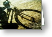 Cyclist Greeting Cards - Shadow of a person riding a bicycle Greeting Card by Sami Sarkis