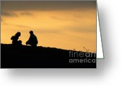 Contemplation Greeting Cards - Silhouette of a squatting couple at sunset Greeting Card by Sami Sarkis