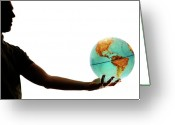 Fingertips Greeting Cards - Silhouette of man holding globe Greeting Card by Sami Sarkis