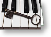 Pianos Greeting Cards - Skeleton key on piano keys Greeting Card by Garry Gay