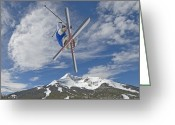 Ski Jump Greeting Cards - Skiing Aerial Maneuvers Off A Jump Greeting Card by Gordon Wiltsie