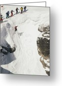 Athletes Greeting Cards - Skilled Skiers Plunge More Than 15 Feet Greeting Card by Raymond Gehman