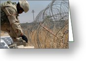 Iraq Greeting Cards - Soldier Checks A Solar-powered Security Greeting Card by Stocktrek Images