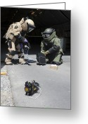 Suspicion Greeting Cards - Soldiers Dressed In Bomb Suits Examine Greeting Card by Stocktrek Images