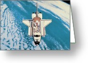 Space.planet Greeting Cards - Space Shuttle In Orbit Around The Earth Greeting Card by Stockbyte