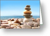 Shore Digital Art Greeting Cards - Stack of pebble stones on white Greeting Card by Sandra Cunningham