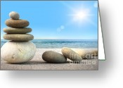 Blue Cobblestone Greeting Cards - Stack of spa rocks on wood against blue sky Greeting Card by Sandra Cunningham