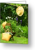 Clothesline Greeting Cards - Straw hat hanging on clothesline Greeting Card by Sandra Cunningham