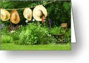 Clothesline Greeting Cards - Summer straw hats hanging on clothesline Greeting Card by Sandra Cunningham