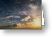 Cumulus Cloud Greeting Cards - Sun Rising Illuminating Clouds In The Dawn Sky Greeting Card by Geoff Tompkinson