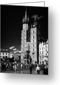 Old Krakow Greeting Cards - The 14th century gothic basilica of the Virgin Mary with tourists in rynek glowny town square krakow Greeting Card by Joe Fox