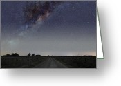 Starfield Greeting Cards - The Milky Way Galaxy Over A Rural Road Greeting Card by Luis Argerich