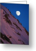 Snow Scenes Greeting Cards - The Moon Rises Over A Snow-covered Greeting Card by Bill Hatcher