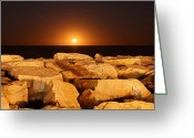 Moonrise Greeting Cards - The Moon Rising Behind Rocks Lit Greeting Card by Luis Argerich