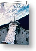 Shuttle Greeting Cards - The Space Shuttle With Its Open Cargo Bay Orbiting Above The Earth Greeting Card by Stockbyte