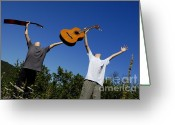 12-13 Years Greeting Cards - Two boys standing in meadow holding guitars in outstretched arms Greeting Card by Sami Sarkis