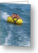 12-13 Years Greeting Cards - Two children on inflatable ring Greeting Card by Sami Sarkis