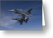 Armament Greeting Cards - Two F-16s Manuever On An Air-to-air Greeting Card by HIGH-G Productions