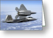 Fighter Jets Greeting Cards - Two F-22a Raptors In Flight Greeting Card by Stocktrek Images