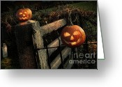 Glowing Greeting Cards - Two halloween pumpkins sitting on fence Greeting Card by Sandra Cunningham