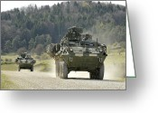 Armored Vehicles Greeting Cards - Two Stryker Vehicles At The Hohenfels Greeting Card by Stocktrek Images