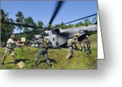 Humanitarian Aid Greeting Cards - U.s. Airmen And Marines Unload Relief Greeting Card by Stocktrek Images