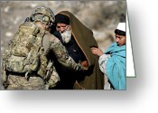 Camouflage Clothing Greeting Cards - U.s. Army Sergeant Helps A Town Elder Greeting Card by Stocktrek Images