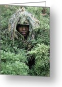 Camouflage Clothing Greeting Cards - U.s. Army Soldier Demonstrates The Use Greeting Card by Stocktrek Images