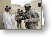 Villagers Greeting Cards - U.s. Army Soldier Shakes Hands With An Greeting Card by Stocktrek Images