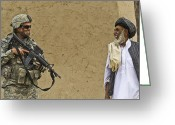 Villagers Greeting Cards - U.s. Army Specialist Talks To An Afghan Greeting Card by Stocktrek Images