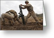 Color Bending Greeting Cards - U.s. Marine Drops A Mortar Round Greeting Card by Stocktrek Images