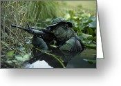 Camouflage Clothing Greeting Cards - U.s. Navy Seal Crosses Through A Stream Greeting Card by Tom Weber