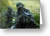 Firearms Photo Greeting Cards - U.s. Navy Seals Cross Through A Stream Greeting Card by Tom Weber