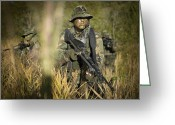 Special Weapons Greeting Cards - U.s. Navy Seals Walk Through Tall Grass Greeting Card by Tom Weber
