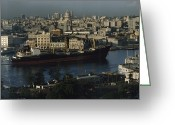Harbors Greeting Cards - View Of City And A Massive Freighter Greeting Card by James L. Stanfield