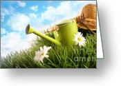 Outdoor Still Life Greeting Cards - Water can and straw hat laying in grass Greeting Card by Sandra Cunningham
