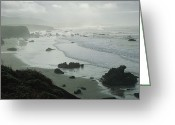 San Simeon Greeting Cards - Waves Wash Ashore On A Fog-shrouded San Greeting Card by Marc Moritsch