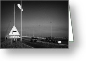 Precaution Greeting Cards - Windsock And Warning Signs About High Winds On The Foyle Bridge Over The River Foyle Derry City  Greeting Card by Joe Fox
