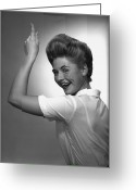Hair Bun Greeting Cards - Woman Pointing Up In Studio, (b&w), Portrait Greeting Card by George Marks