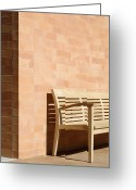 Empty Park Bench Greeting Cards - Wooden Bench Against Corner of Brick Building Greeting Card by Jeremy Woodhouse