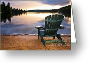 Adirondack Greeting Cards - Wooden chair at sunset on beach Greeting Card by Elena Elisseeva