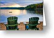 Adirondack Greeting Cards - Wooden chairs at sunset on beach Greeting Card by Elena Elisseeva