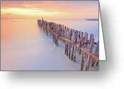 Dusk Greeting Cards - Wooden Posts Into  Sea Greeting Card by Enzo Figueres