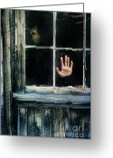 Depressed Greeting Cards - Young Woman Looking Through Hole in Window Greeting Card by Jill Battaglia