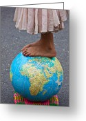 Spheres Greeting Cards - Young woman standing on globe Greeting Card by Garry Gay