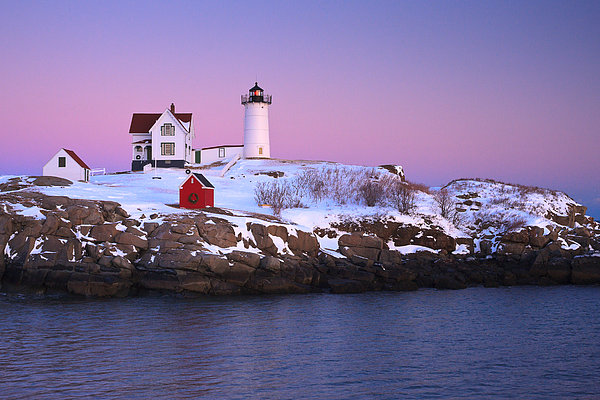 Nubble Light Under A Pastel Winter Sky Print by Jeff Sinon