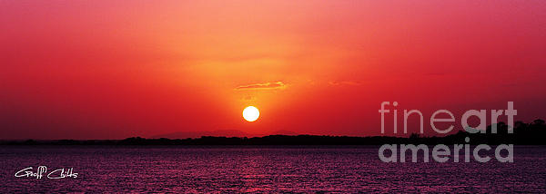 White Sun And Crimson Glow - Sunset Xmas Day. Print by Geoff Childs