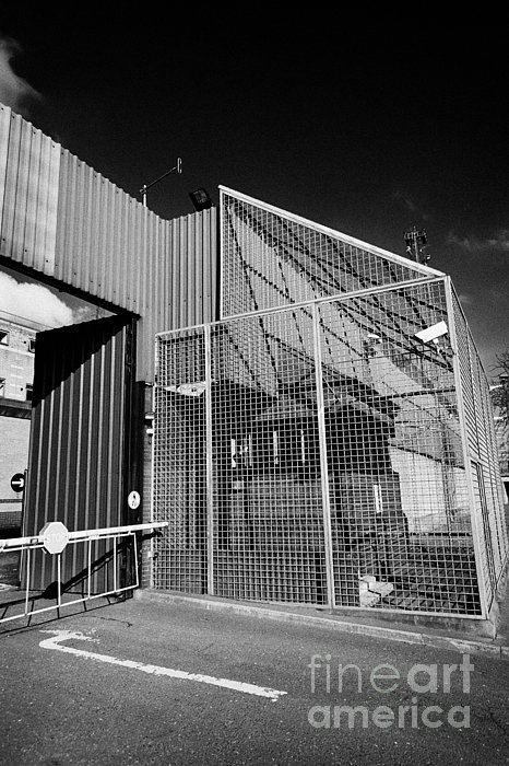 anti rpg cage surrounding observation sanger at North Queen Street PSNI police station Belfast North Print by Joe Fox