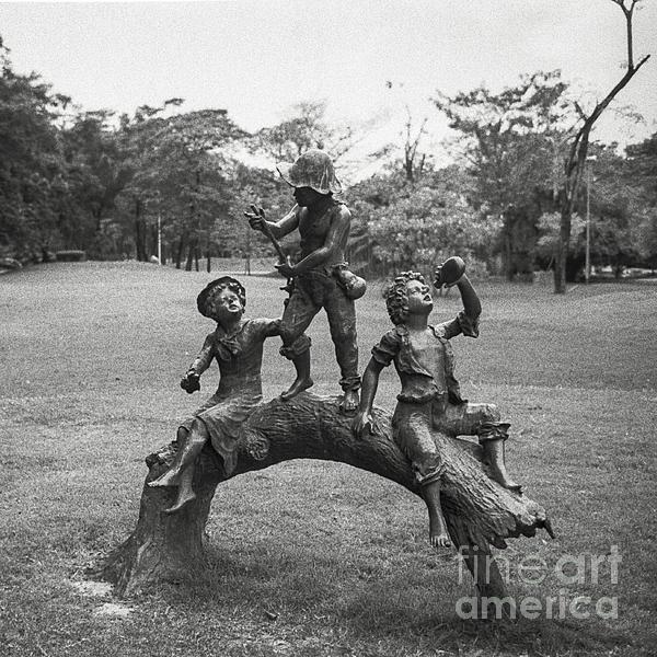 Children Sculpture In The Garden Print by Setsiri Silapasuwanchai